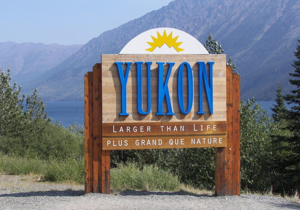 1200px-Yukon_border_sign_on_Klondike_Highway